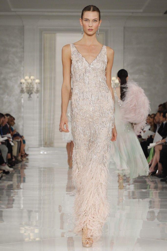Metallic champagne sheath wedding dress with feather and beading embellishments