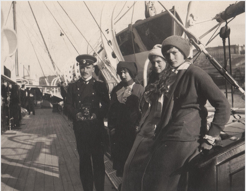 Grand Duchesses Anastasia, Maria, and Tatiana with an officer aboard the Standart: 1914.The Mauve Room