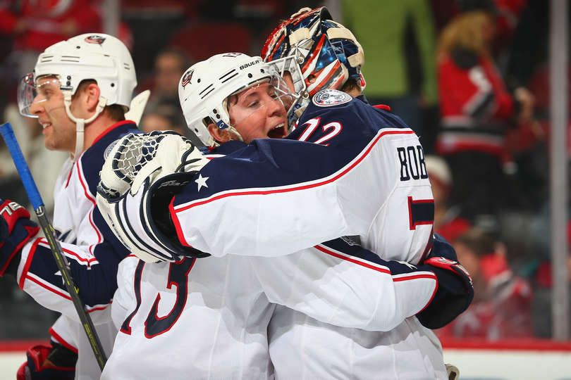 NEWARK, NJ - MARCH 05: Cam Atkinson #13 of the Columbus Blue Jackets congratulates Sergei Bobrovsky #72 on his shut-out against the New Jersey Devils at Prudential Center on March 5, 2017 in Newark, New Jersey. The Blue Jackets defeated the Devils 3-0. (Photo by Andy Marlin/NHLI via Getty Images)