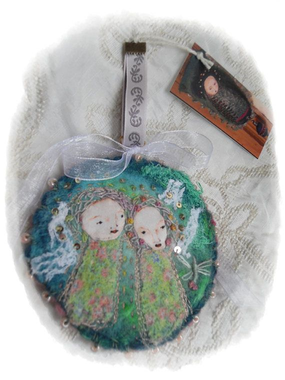 The Angels and the Dragonfly:  hand embroidered piece by Sara Lechner, Argentina and sold on Etsy.