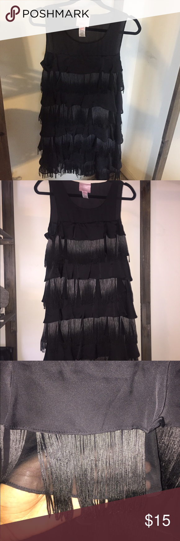 Romeo + Juliet Couture black fringe dress Black fringe and ruffle dress by Romeo + Juliet Couture. Size M. Ombre fringe from a greyish/silver to black. Cute dress for a party or whatever you choose! Side zipper. Romeo & Juliet Couture Dresses Mini