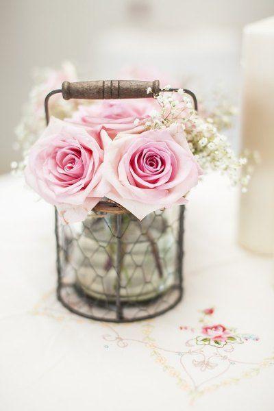 Mason jar flowers in wire basket