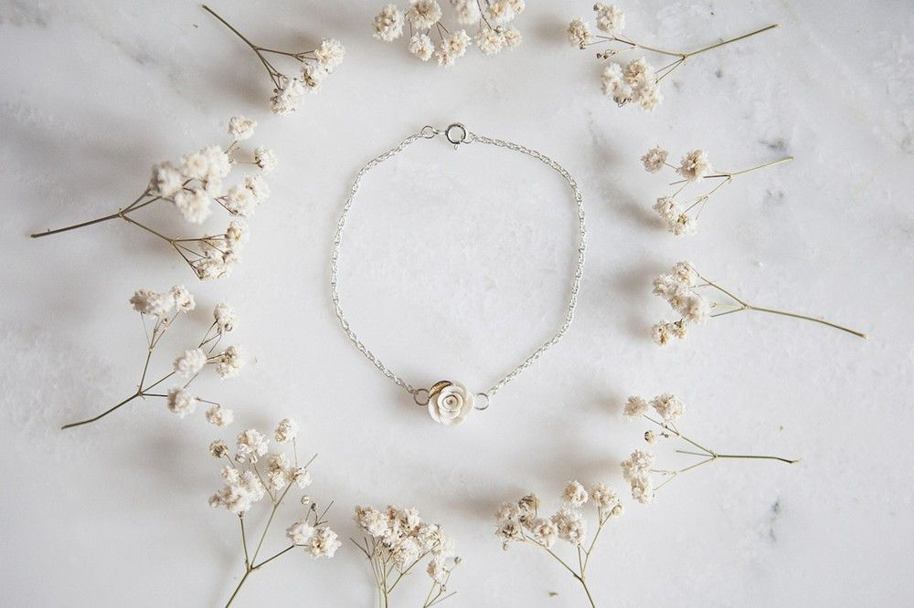 Delicate porcelain gyp and white rose bracelet by Marie Canning.