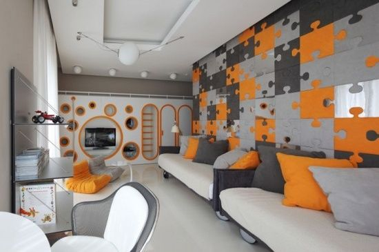 This grey and orange playroom is every kids dream