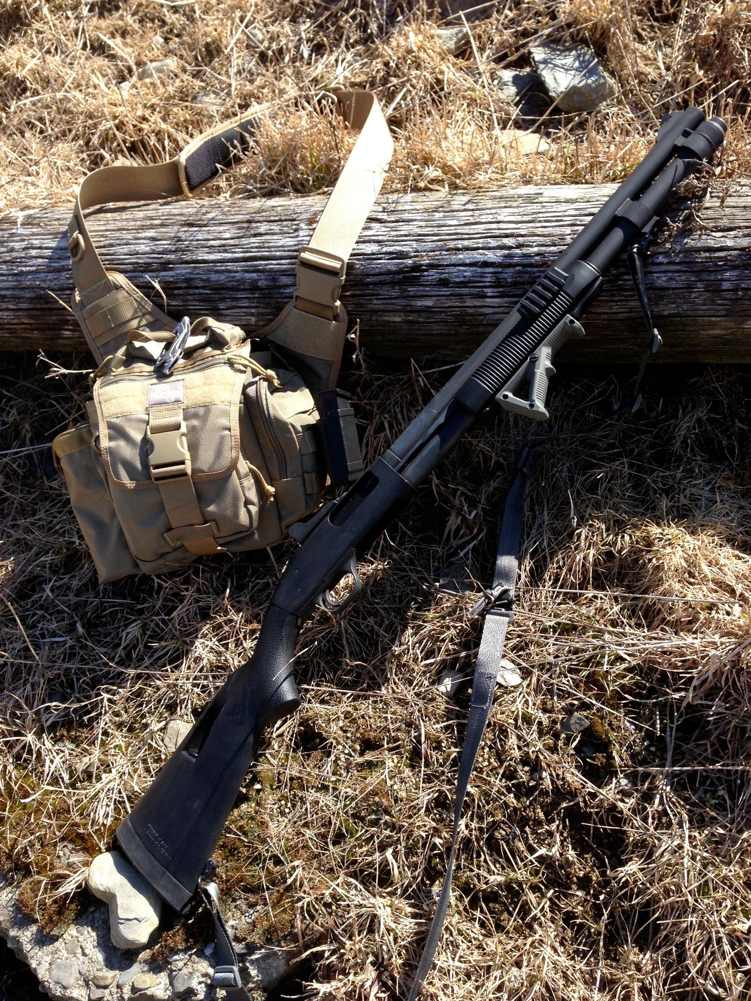 """Mossberg 590A1 with Viking Tactics Sling, GGG QD sling swivels, Magpul AFG, tri-rail MOE Forearm, QTac Weaponlight mount, Speedfeed Stock, GhostRing Sight, & 9 rounds of """"wrong fucking house dipshit!"""""""