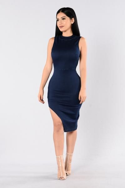 - Available in Dark Denim - Denim Dress - Stretch Material - Midi Length - Side Slit - Round Neckline - Sleeveless - Open Back - 77% Cotton 20% Polyester 2% Spandex