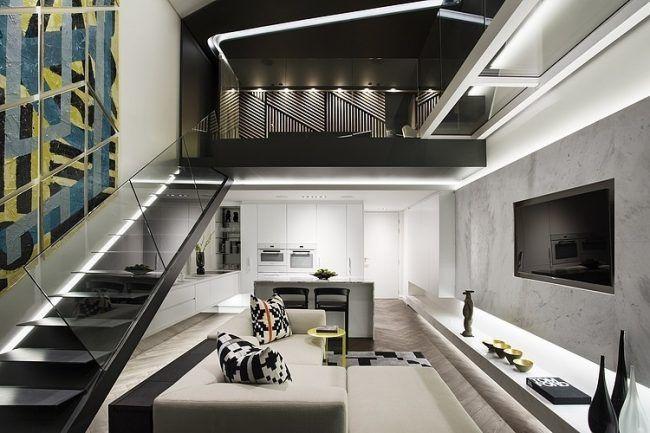 Wohnzimmer in Grau -eckcouch-modern-indirekte-led-beleuchtung-treppe