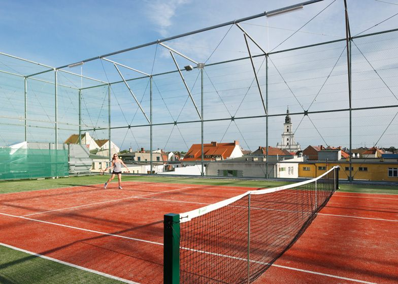 Stray balls aren't a problem on the rooftop tennis court of this sports centre in western Poland, thanks to the cage that covers the building.