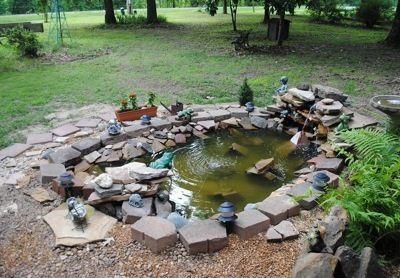 Building a garden pond ducklings ponds backyard pond for Garden duck pond design