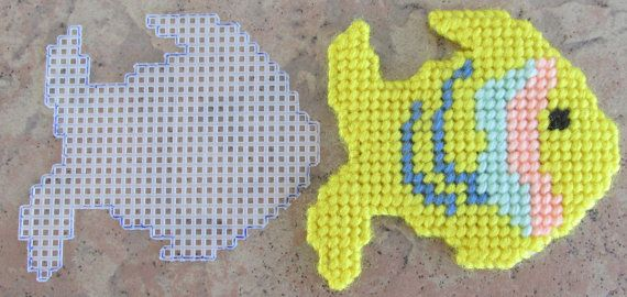 Handmade Plastic Canvas Fish with cut out measures about 4 1/2 X 3 1/2 Can be made into Coaster Ornament, Magnet, or package decoration.
