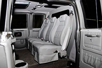 Interior Of An Executive 12 Passenger Explorer Conversion Van With Leather Seating And Luxury Trim
