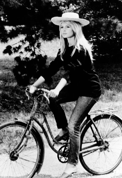 Brigitte Bardot--simplicity in flats, slim jeans and long sweater topped with traditional straw hat