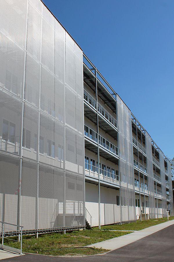 Maison des sport talence haver architectural mesh facade as an effective sun - Facade architecture maison ...