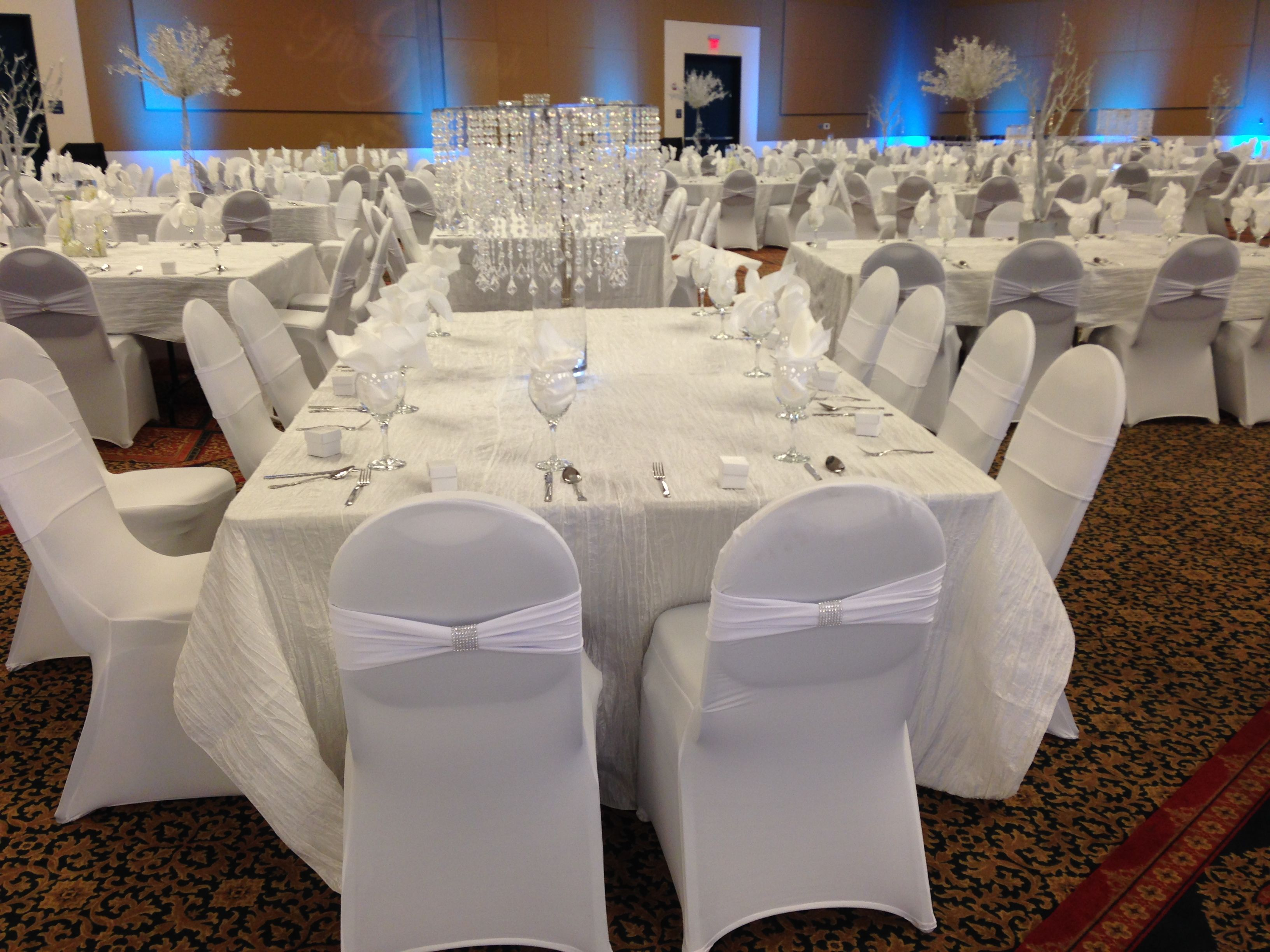 White Spandex Chair Cover With White Spandex Bands And Silver