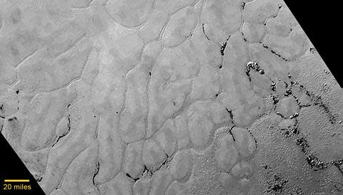 New images from NASA's New Horizons spacecraft reveal an ice-covered plain on Pluto that looks remarkably young and fresh.