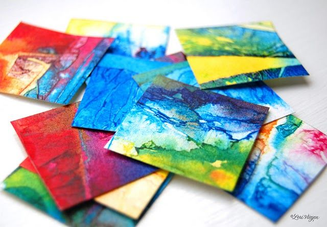 Saran wrap on super wet watercolor, leave to dry, cut into mini-paintings