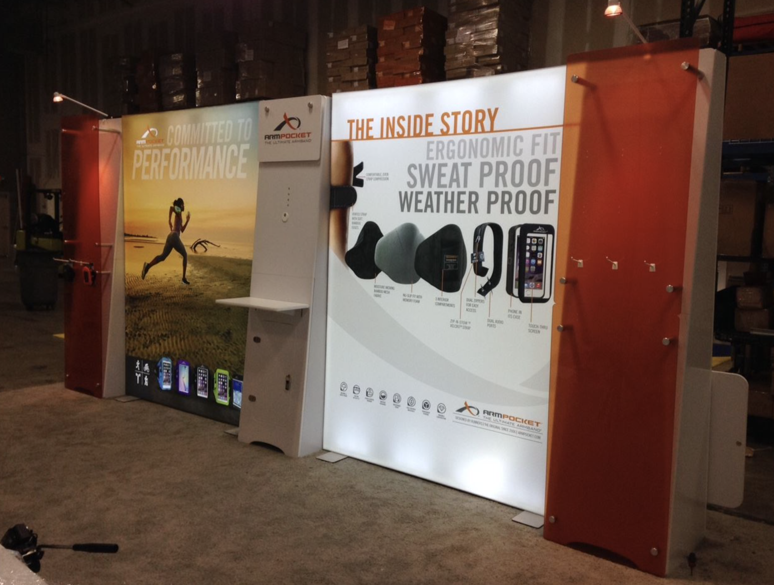 Custom LED backlit trade show display booth with stretch fabric vibrant SEG graphic murals. Starting