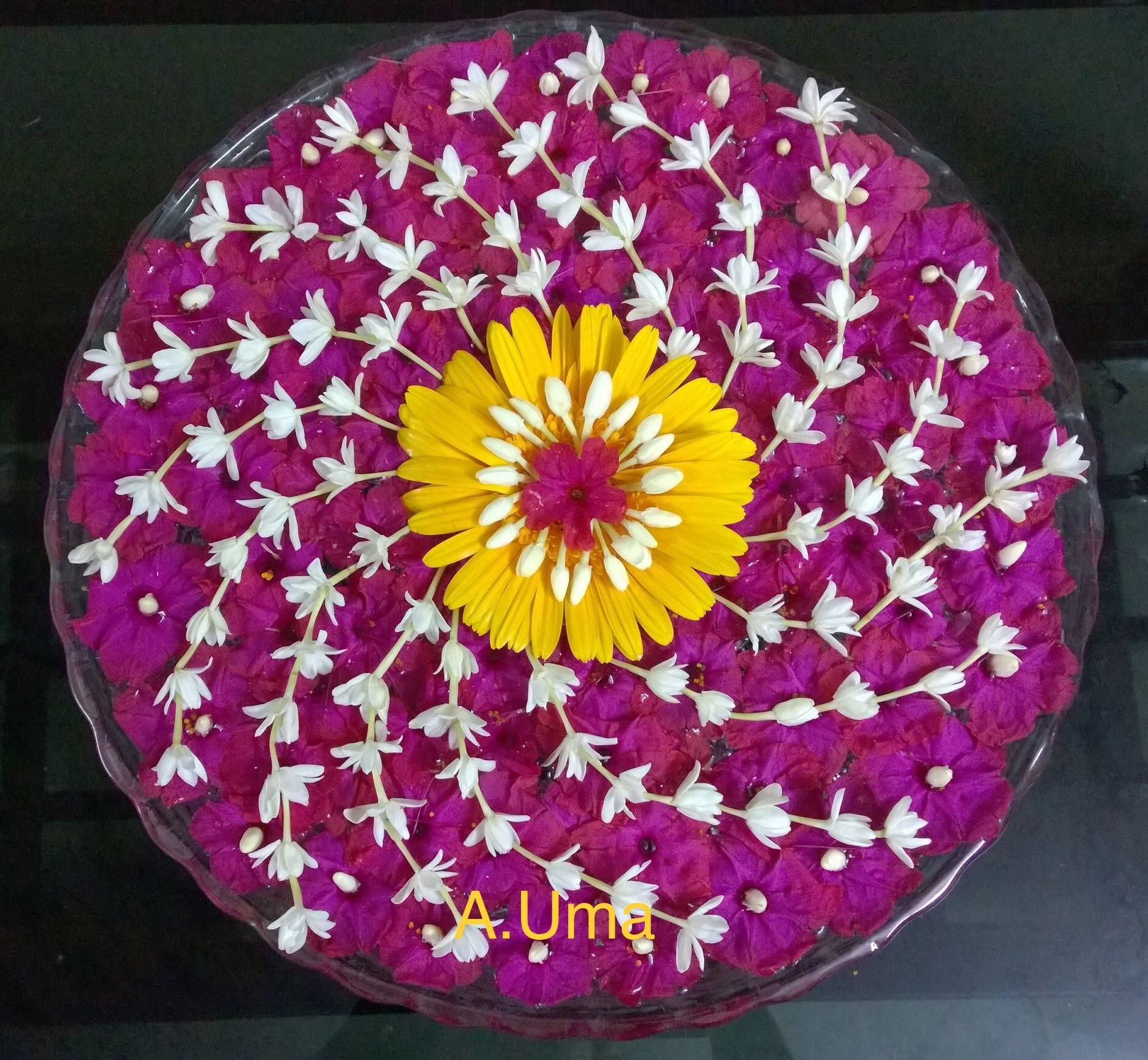 Circular shape flower arrangement Rangoli designs flower