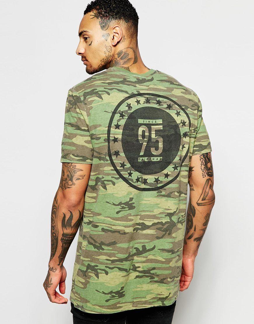 ASOS | Camiseta larga con diseño de camuflaje y estampado en la parte posterior de ASOS en ASOS