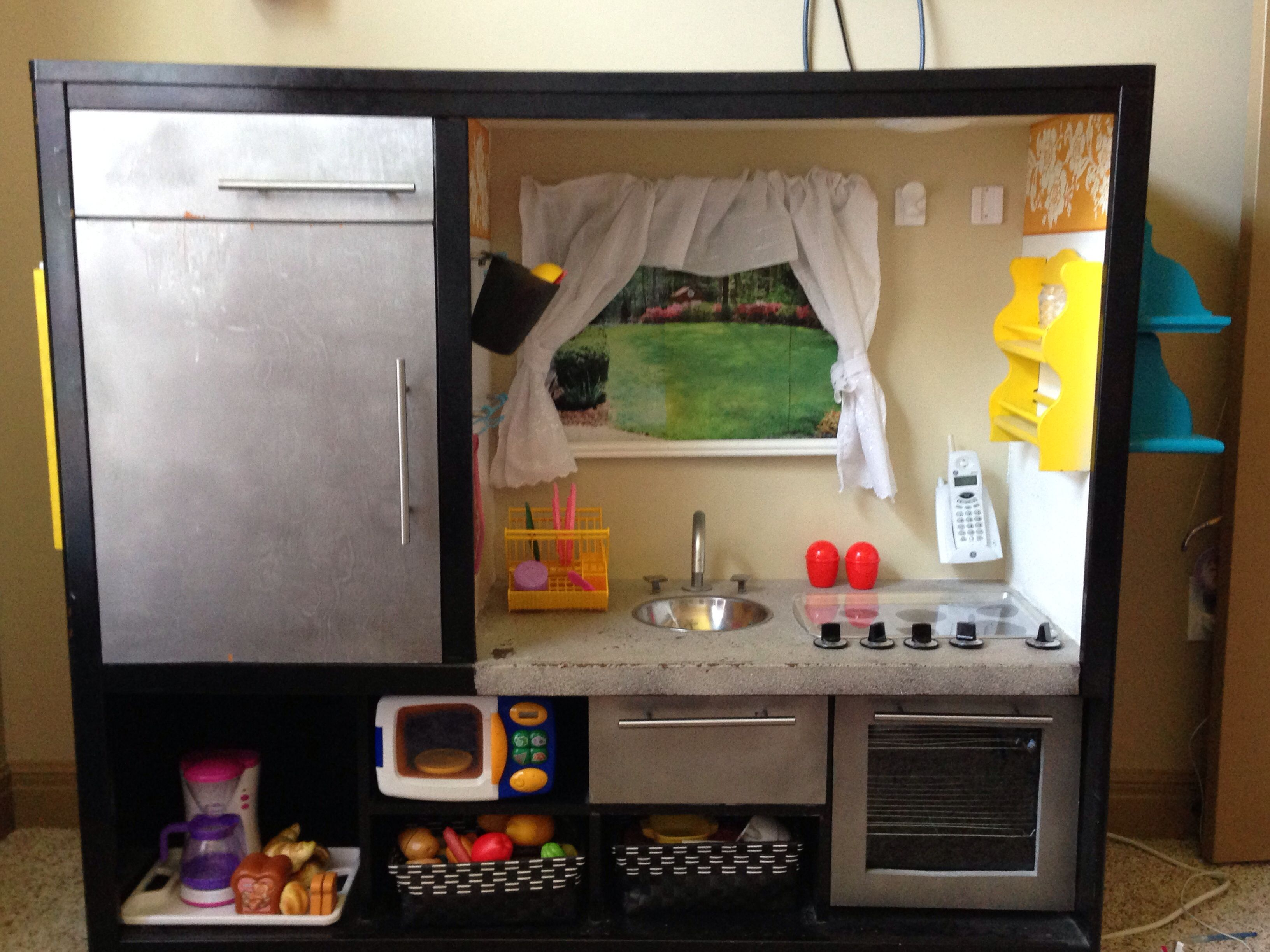 Play kitchen from upcycled entertainment center diy furniture
