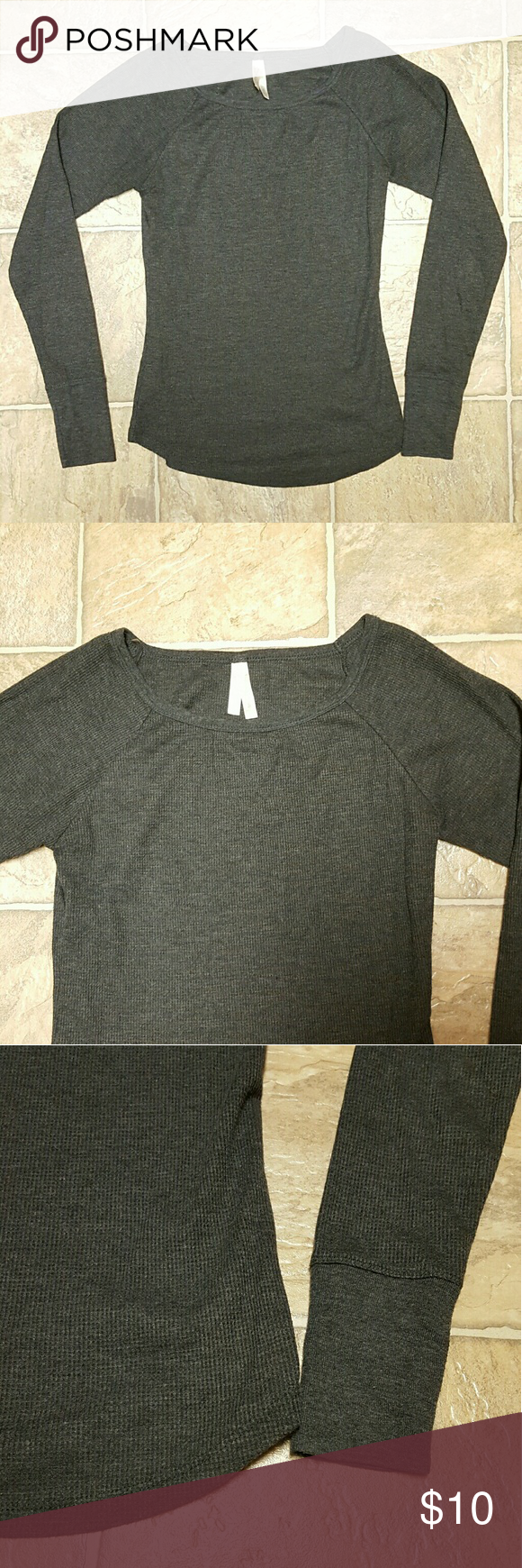 """Gray Long-sleeve Waffle Shirt Long sleeve waffle-knit shirt with a rounded hem. Material is not extremely thick - it's about as thick as any normal shirt, but it's still comfortable and warm. Worn a handful of times and has no defects! It's just a little too small for me now. Shirt also has stretch to it!   Width at waist: 13"""" Length from shoulder to shortest part of rounded hem: 20.5"""" Length from armpit to end of sleeve: 18""""  Price is firm, unless bundled! Color Story Tops Tees - Long…"""