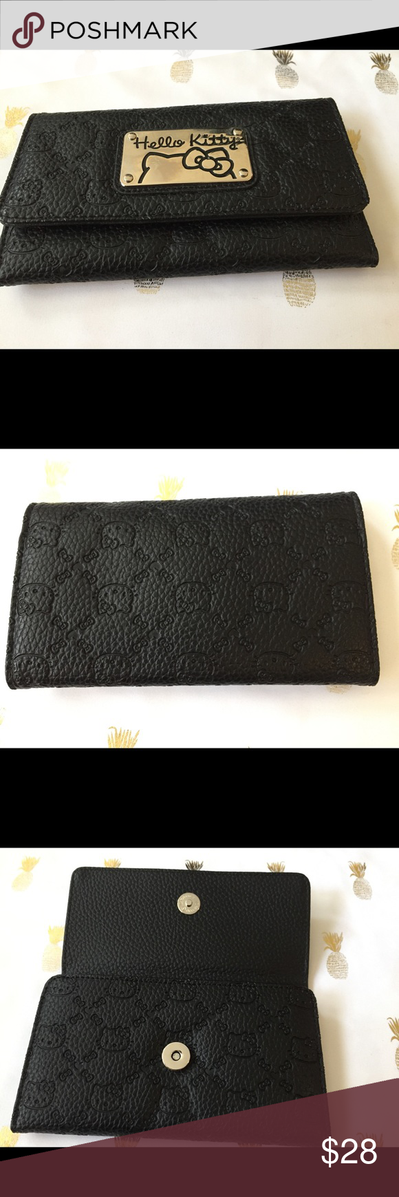 Hello Kitty Wallet Black wallet. With hello kitty embossed on outside. Sanrio Bags Wallets