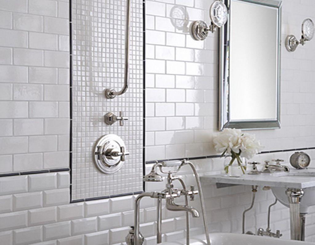 The beautiful bathroom is styled in white porcelain subway tiles and ...