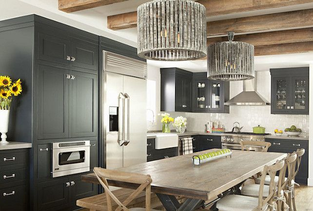 Captivating Kitchen Features Dark Charcoal Gray Cabinets Paired With Gray Countertops  And White Grid Tiled Backsplash. Glass Front Cabinets Flank Stainless Steel  Range ...