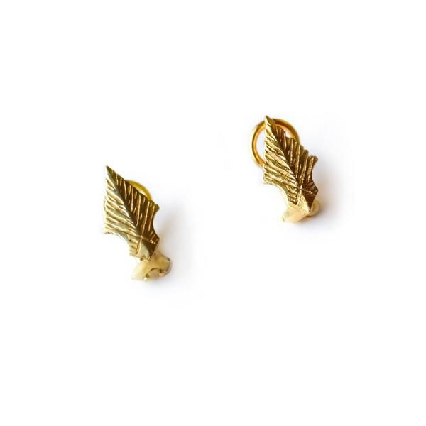 Design Details and Impact Care For Your Akola Leaf Earrings, plated in either 18k gold or sterling silver, showcase the hand-carved Ankole horn cutouts (sold se