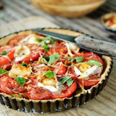 Onion, tomato, goat cheese, and zucchini tart
