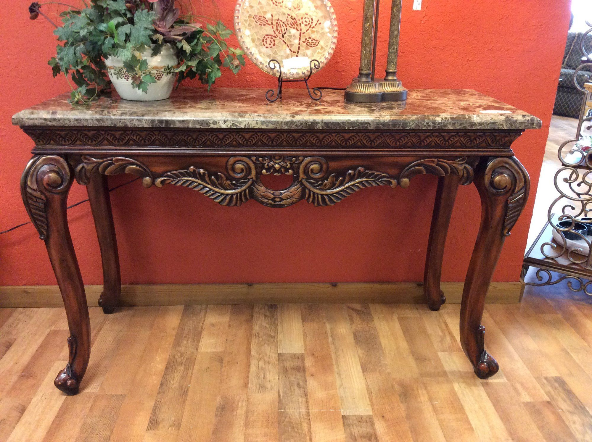 Here is an impressive tall entry or sofa table with detailed ...