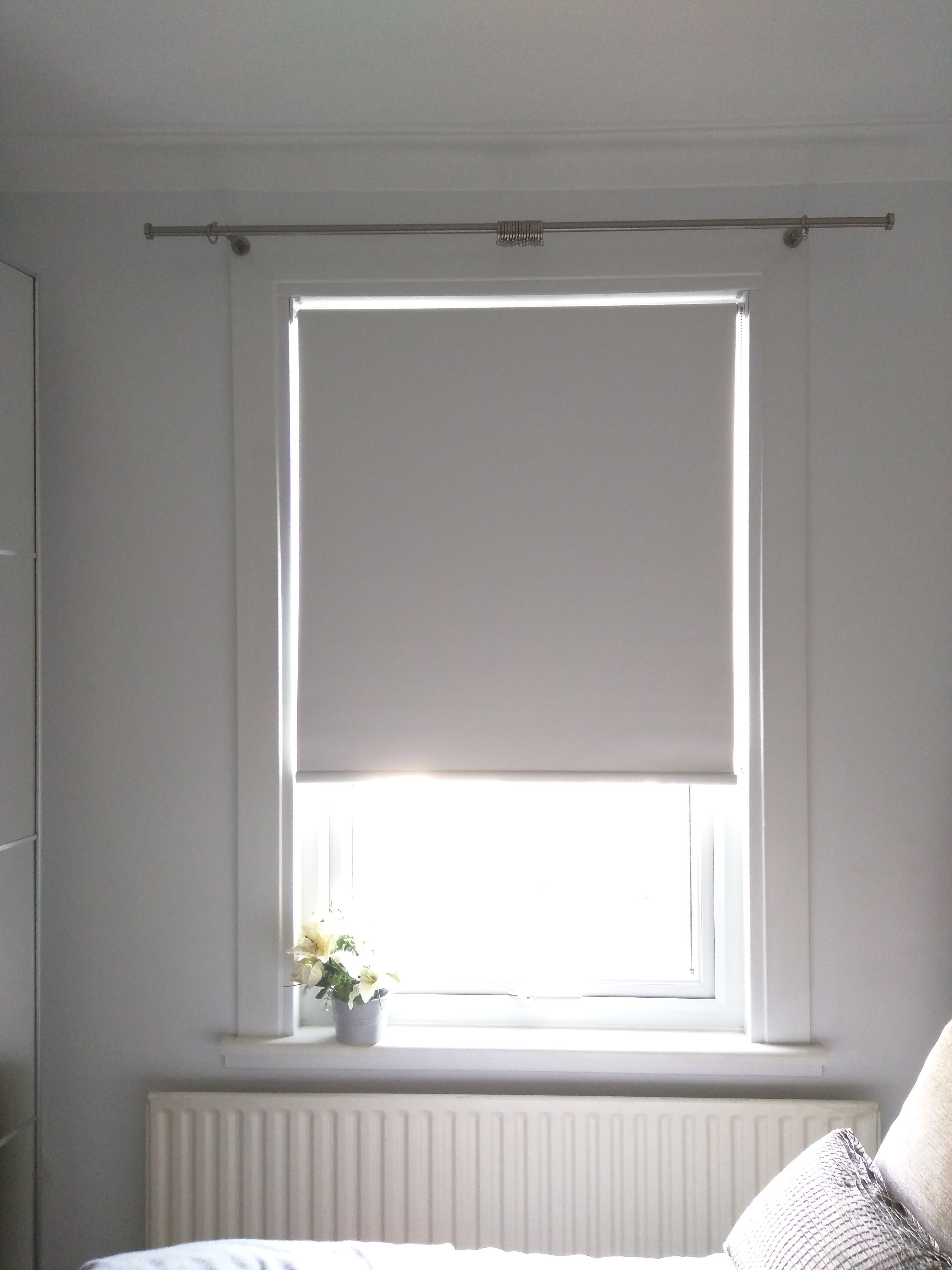 Blackout Roller Blind In Polar White Fitted To Bedroom Window In