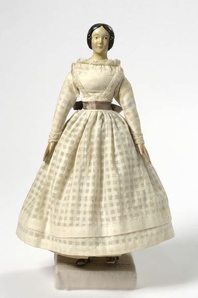 1845. Not sure if the dress is original, but it's pretty accurate.