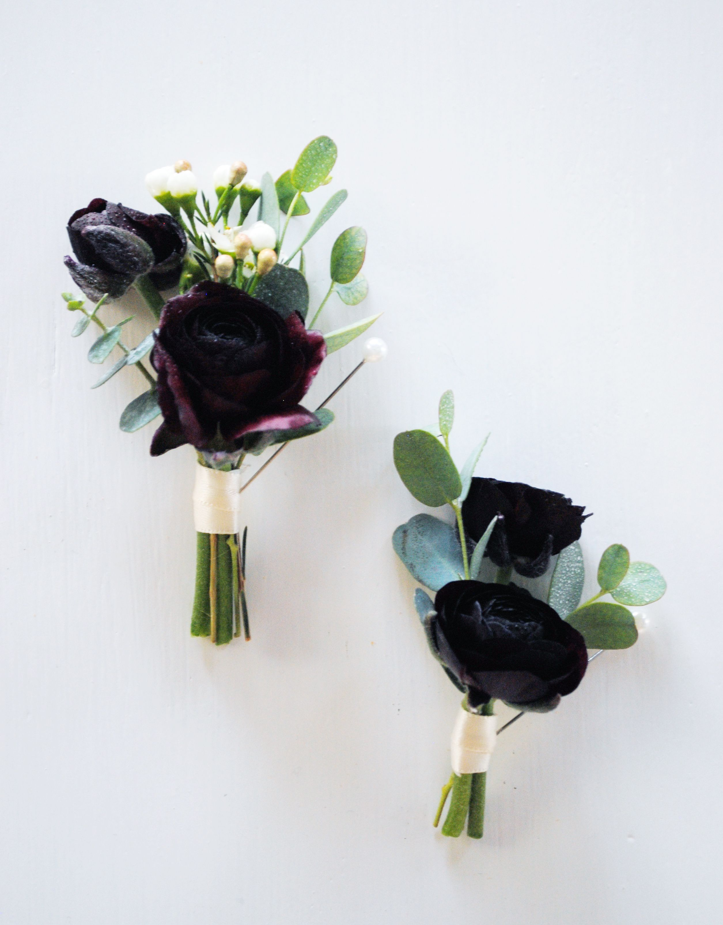 Dark Hued Ranunculus Wax Flower And Eucalyptus Boutonnieres Wax Flowers Petal Floral Wedding