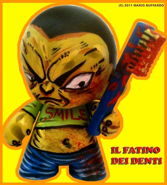 the tooth fairy is a sociopatic killer.  he's two faces: the ungry face and the angriest face. be carefull, he is under your bed!  this picture is for marketing and hasbro. i thik they'll option for a film!  custom toy and acrylic painting.  (c)2011 mario buffardo and raffaella migliaccio