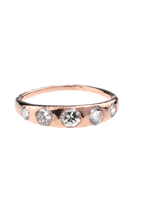 A crescent diamond ring in 14K rose gold by @barioneal | Brides.com