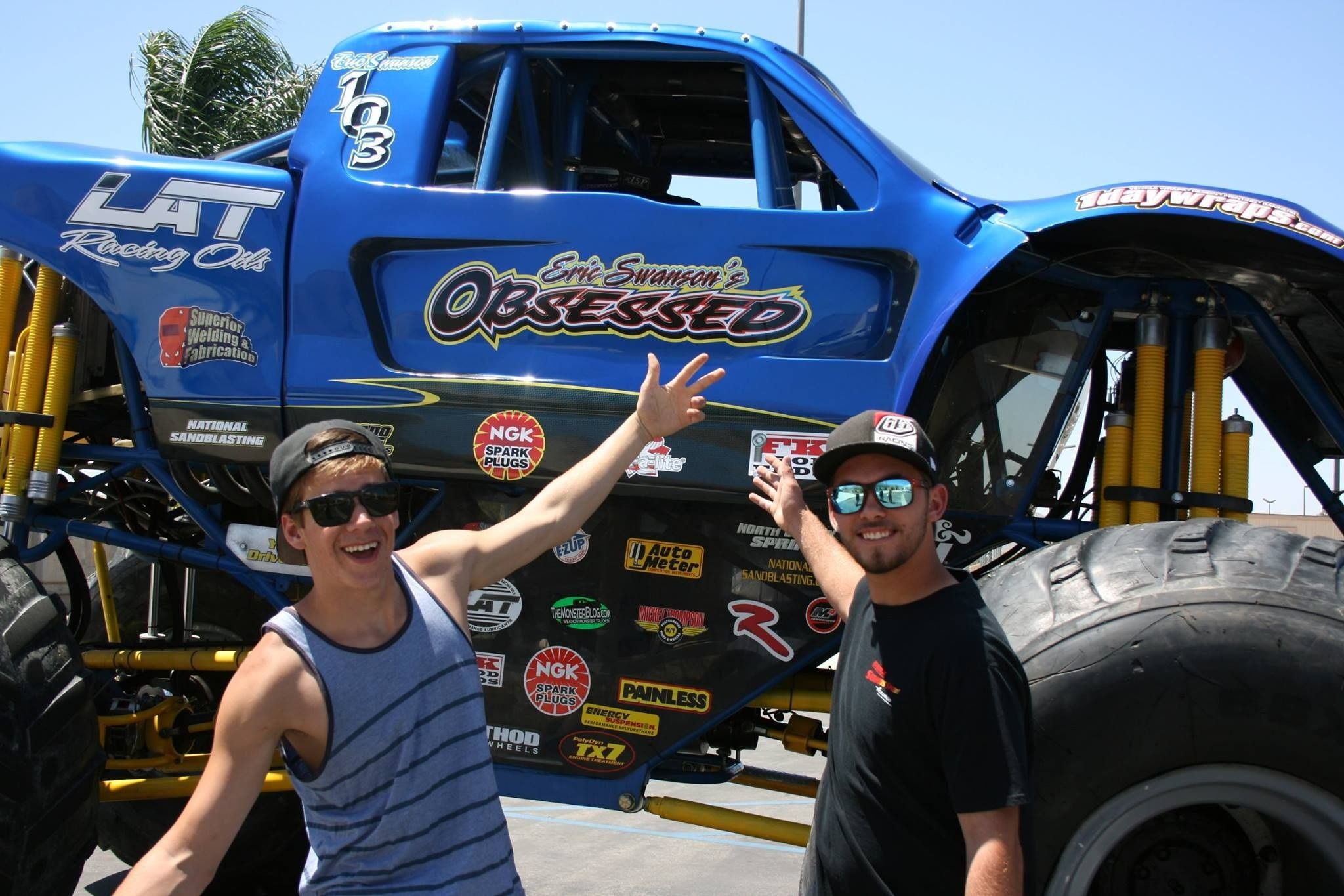 Team rider eric swanson jason posing next to his monster truck obsessed