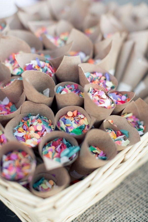 give your wedding guests confetti sprinkles or glitter to throwinstead of