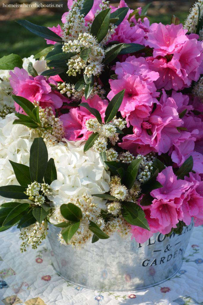 A Garden Table Setting With Azaleas Roses And Snowballs Azalea Flower Flower Arrangements Spring Arrangements