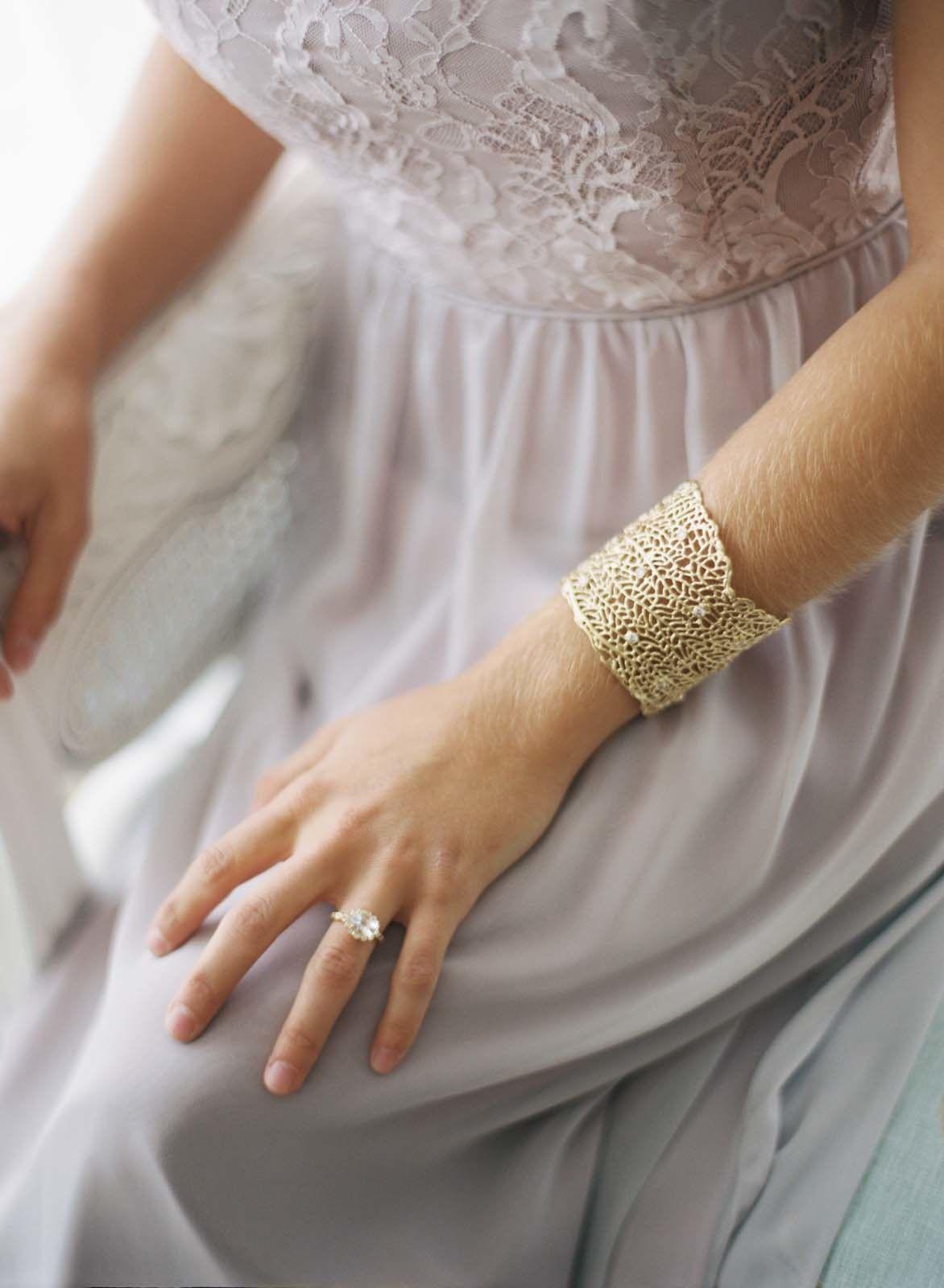 Gorgeous gold bracelet from Kira Kira - kirakira.com | Photography: Elisa Bricker - elisabricker.com  Read More: http://www.stylemepretty.com/2014/03/06/bridesmaids-tea-at-trump-winery/