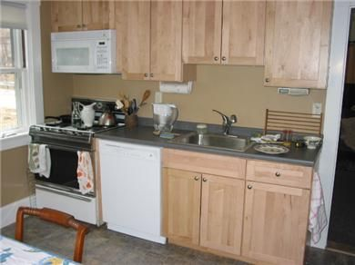 Kitchen With Dishwasher And Stove