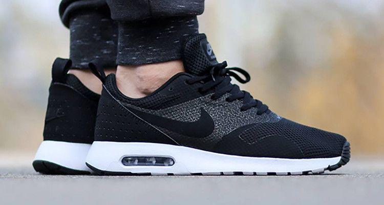 new product 9023d 38070 Nike Air Max Tavas comes at us in a black and white colorway, reminding us  that sometimes, less is more.