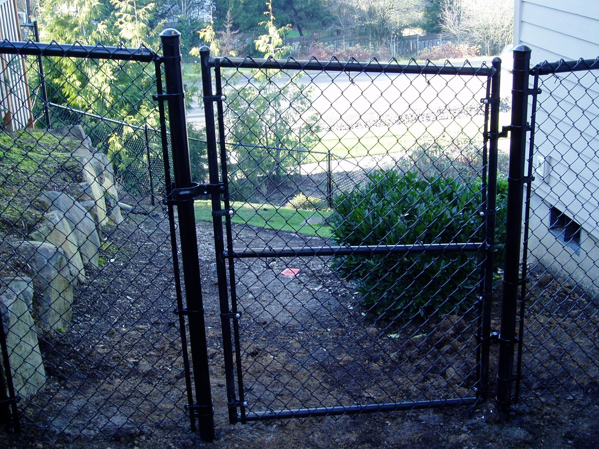 Small Black Chain Link Gates Look Great On The Side Of Your House