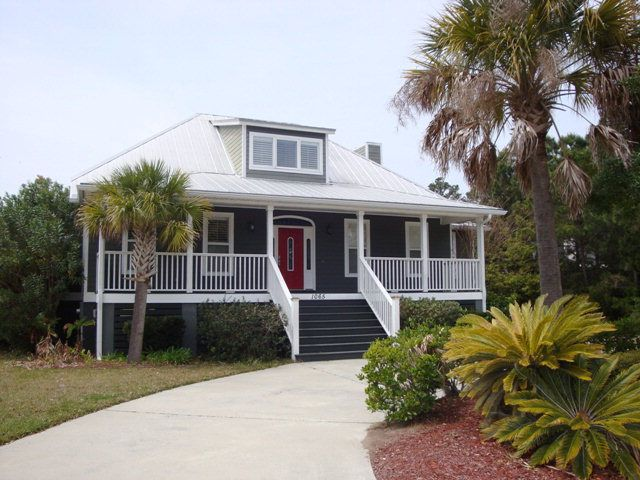 This custom built home offers 3 bedrooms with 3 full baths with a nice open floorplan.  Many features include a fireplace in the family room, spacious master bedroom, hardwood flooring,detached 2 car garage with covered breezway, screened porch and patio. St Simons Island, GA