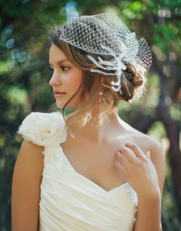 side bun with birdcage veil wedding