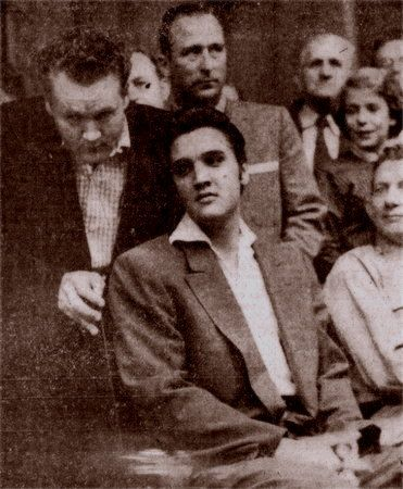 Elvis at the court house in Memphis in october 19 1956.The day before Elvis was booked for assault and battery at a gas station, but all charges were dropped against Elvis .