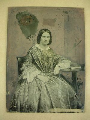 Ambrotype Glass Plate of Young Woman Antique 1850s   Note: Fan Front Dress. Edge of sleeve is fringed. Large brooch with figure, bracelets of both wrists, long string of beads, beaded hair net. Flounced undersleeves with lace trim.