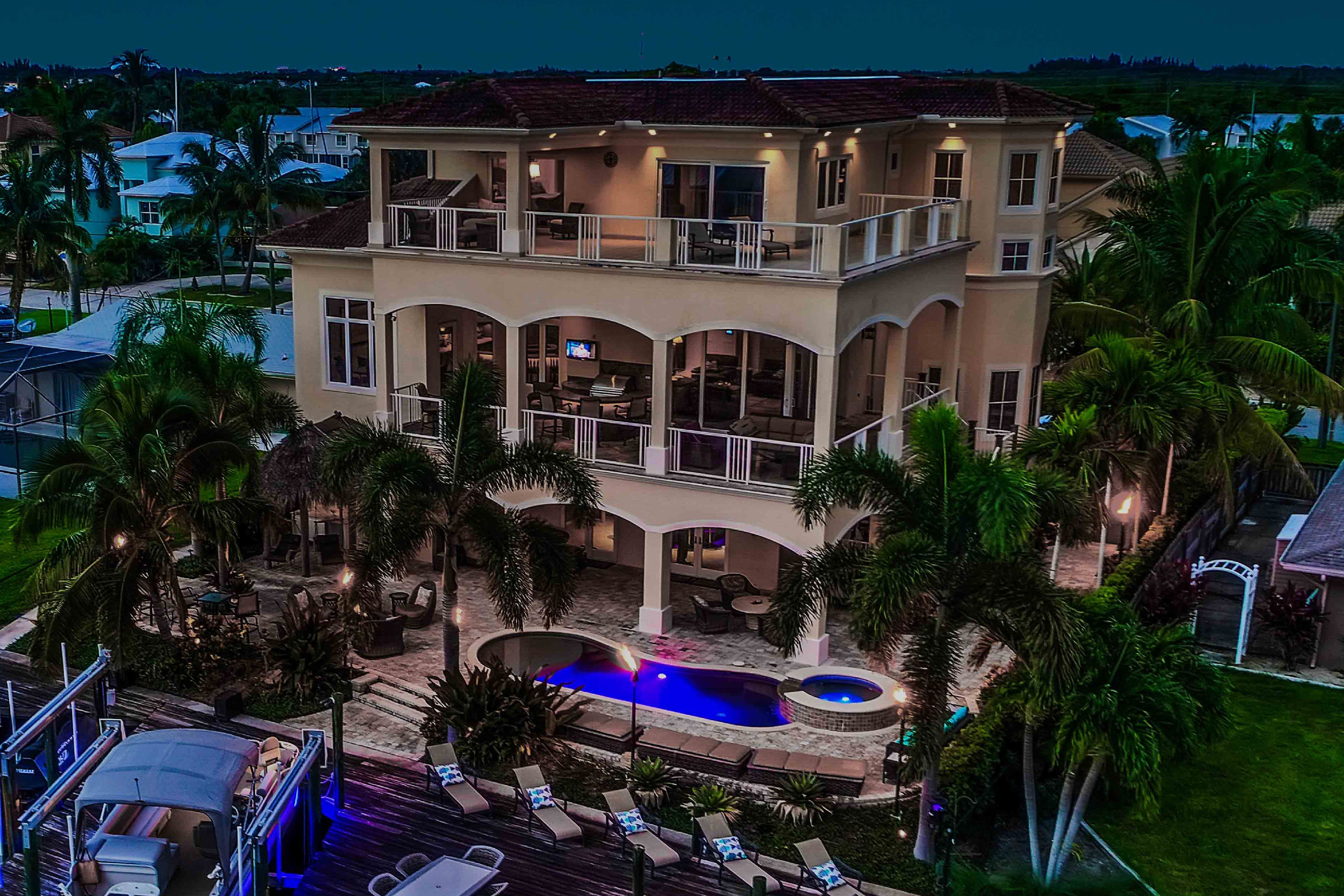 Night Shot Of The Back Of This Very Large Three Story Fort Myers Beach Luxury Home Currently For Sale For 2 495 000 Waterfront Homes Fort Myers Luxury Homes