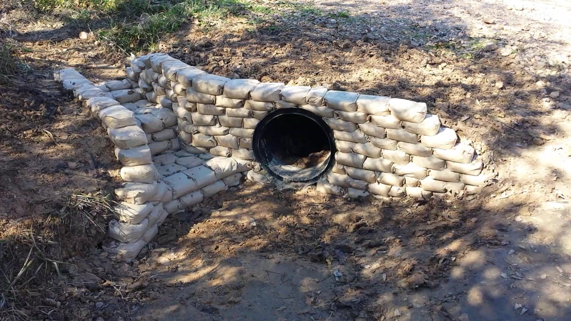 Building A Cement Bag Retaining Wall Around A Culvert By Pouring Dry Concrete Mix In Small Lunch Bags And Concrete Retaining Walls Concrete Bags Retaining Wall