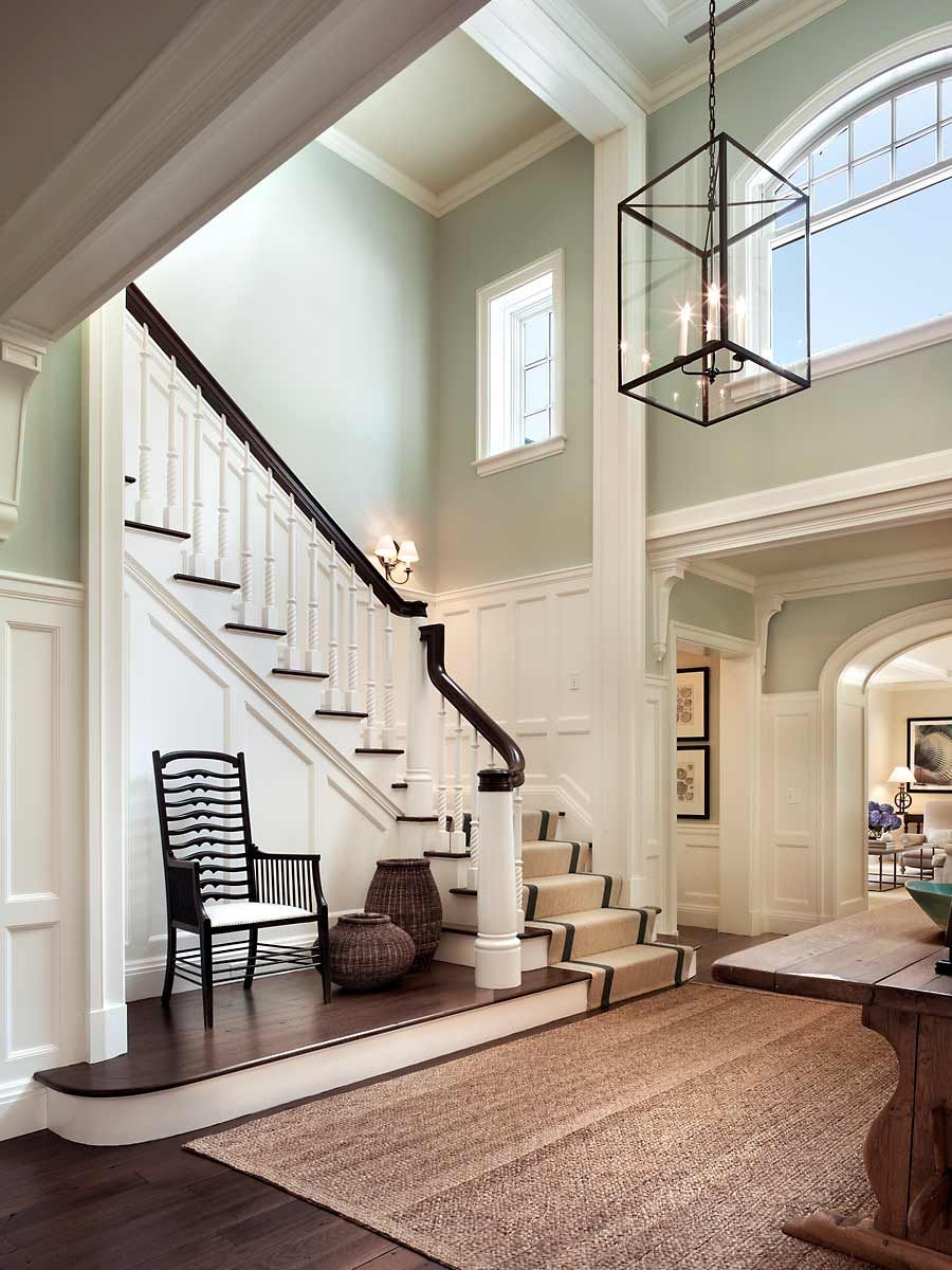 Stair hall with white paneling aqua walls u natural seagrass rug